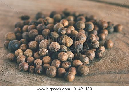 Allspice On An Old Wooden Table