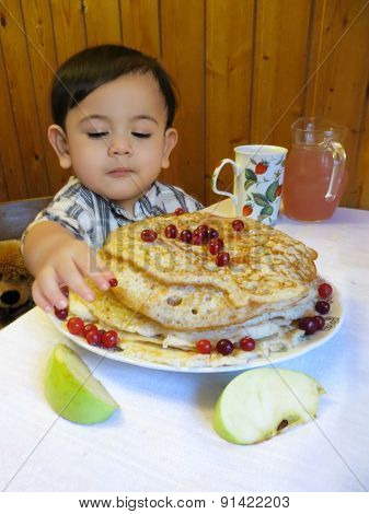 Baby boy with Easter pancakes