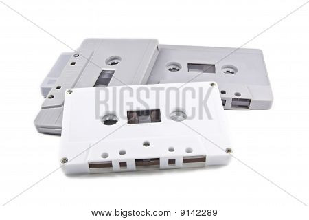 A Pile Of Cassettes On The White Background