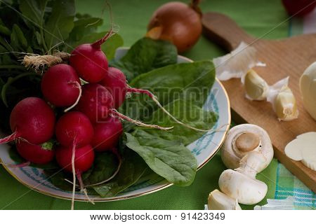 Bunch On Radishes Plus Spinach And Mushrooms