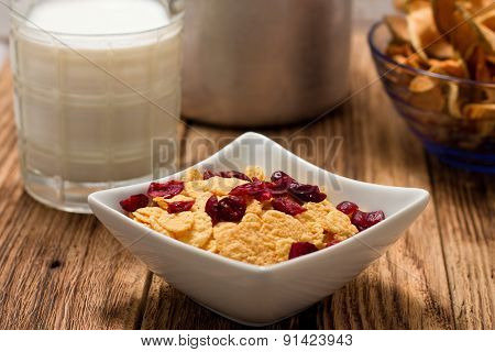 Modern Square Bowl With Cornflakes In Front Of Glass Of Milk