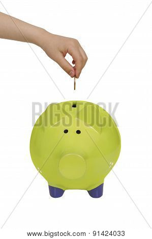 Green Piggy Bank And Child Hand Isolated Over White