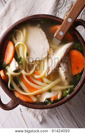 Soup With Noodles And Chicken Close-up. Vertical Top View