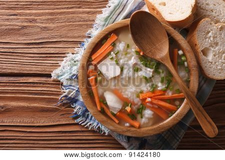 Rice Soup With Meat In A Wooden Bowl. Horizontal Top View
