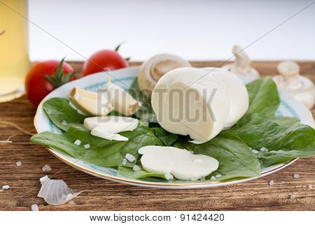 Traditional Slovak Cheese On Plate With Baby Spinach Leaves