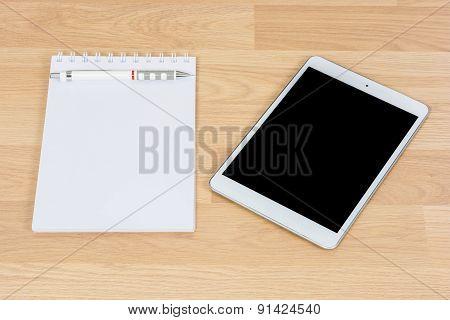 White Digital Tablet On Wooden