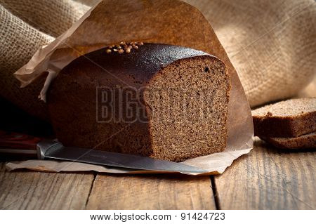 Bread Rye On An Old Wooden Background