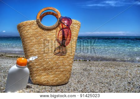 Straw Bag And Suntan Lotion By The Sea In Hdr