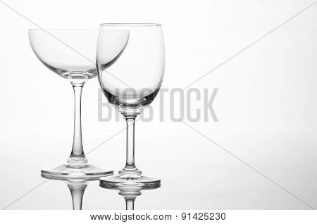 Empty wine glass and cocktail glass art composition creative