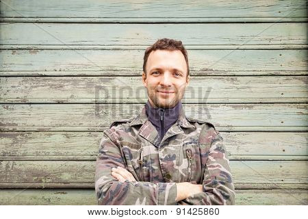 Young Smiling Caucasian Man In Camouflage