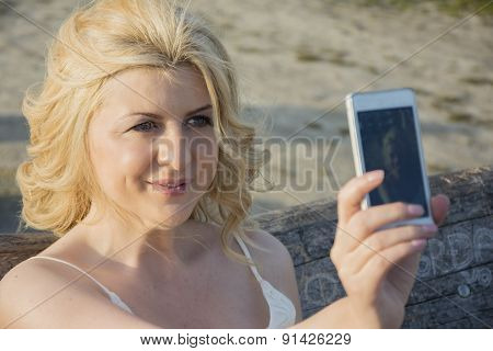 Blond Woman Taking Selfie