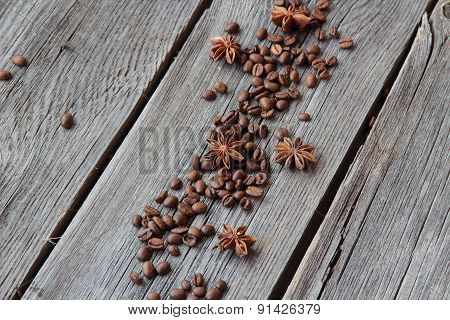 Grains Of Black Coffee And An Anise Asterisk On A Wooden Background