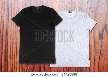 Blank T-shirts On The Background Of Wooden Wall