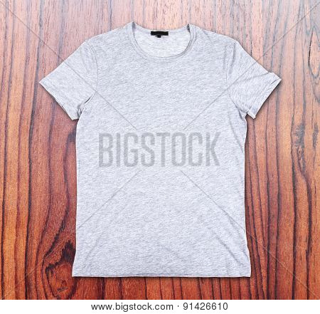 Blank T-shirt On The Background Of Wooden Wall