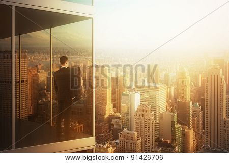 Businessman In The Modern Office Looking At City