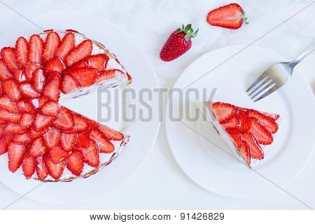 Sliced piece of gourmet homemade celebration strawberry cake sweet dessert food with whipped cream a
