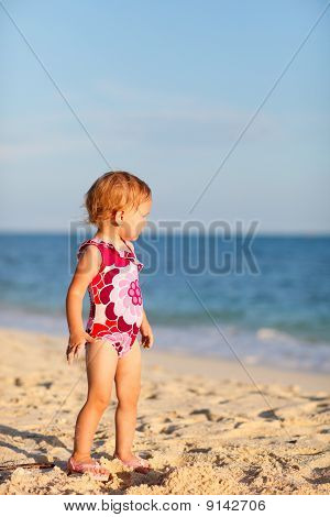 Toddler Girl On Beach At Sunset