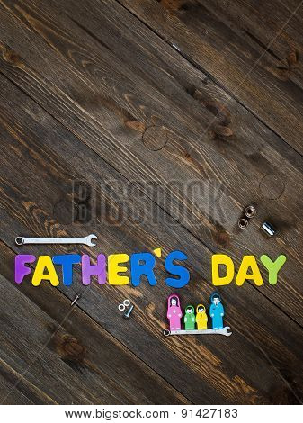 Letters and tools wooden background father's day