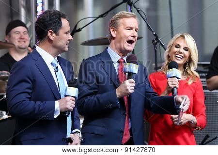 NEW YORK - MAY 22: (L-R) Brian Kilmeade, Steve Doocy and Elisabeth Hasselbeck at Fox and Friends' All-American Summer Concert Series at Fox Studios on May 22, 2015 in New York City.