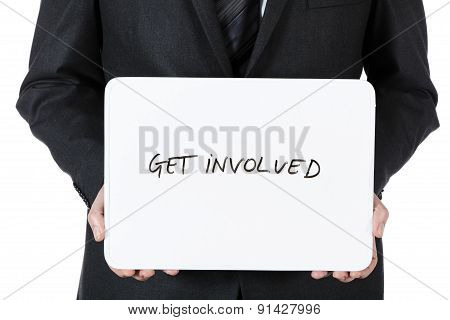 businessman holding whiteboard with text: get involved