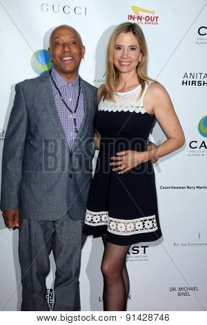 LOS ANGELES - MAY 21:  Russell Simmons, Mira Sorvino at the 17th From Slavery to Freedom Gala at the Skirball Center on May 21, 2015 in Los Angeles, CA