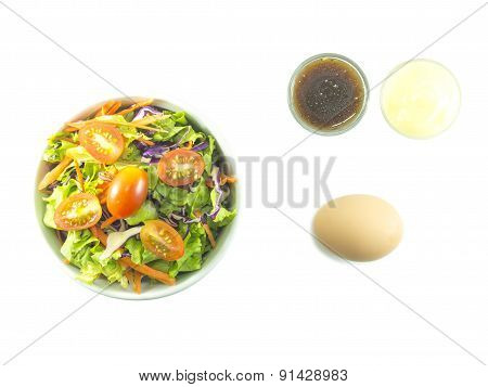 Mixed Salad With Dressing And Boiled Egg