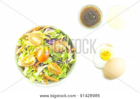 Fresh Salad With Dressing And Boiled Egg