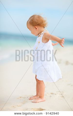 Toddler Girl In White Dress At Beach