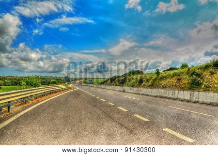Country Road Under A Scenic Sky In Hdr