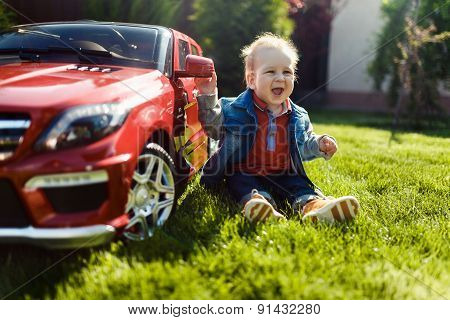 The Child Enjoys His Toy Car