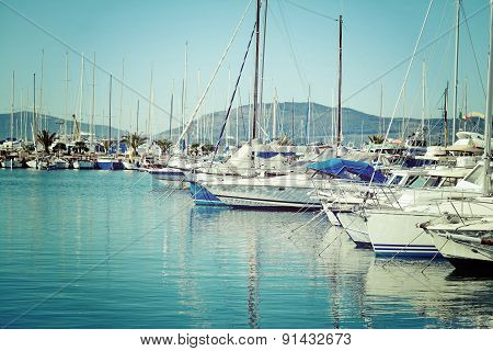 Boats In Alghero Harbor On A Clear Day In Vintage Tone