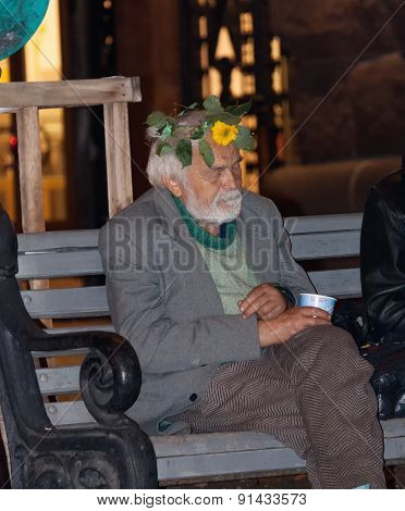 Kiev, Ukraine - September 10,2013: Beggar Man Collecting Alms In The Evening On The Main Street Of K