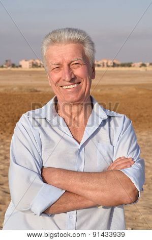 Senior man in desert