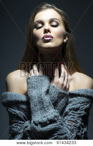 Portrait Of Tender Sensual Woman In Grey Knitted Jacket