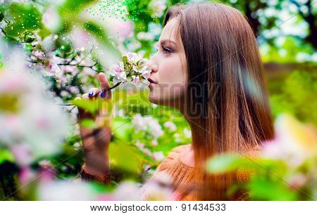 The meeting with summer, the woman smells flowers
