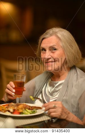 Senior woman having a dinner
