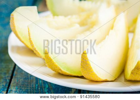 Slices Of Fresh Melon On A Plate Closeup