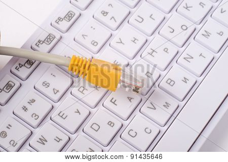 Computer keyboard with yellow cable