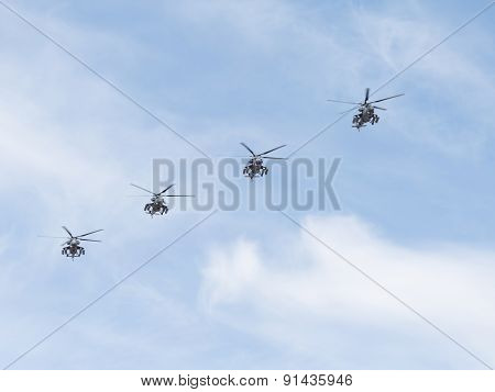 Four Military Helicopters Mi-35 Flying Diagonally