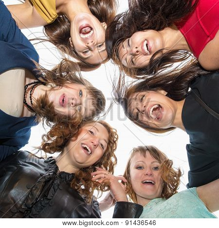 Group Portrait of six beautiful happy young woman