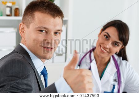Businessman Showing Thumb Up With Doctor