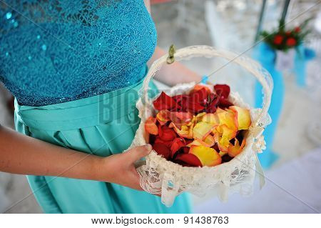Wedding Rose Petals At Hands Of Bridesmaids In Basket