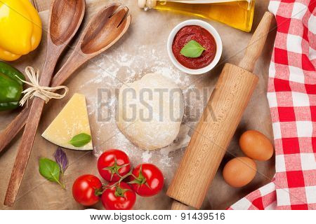 Pizza cooking ingredients. Dough, vegetables and spices