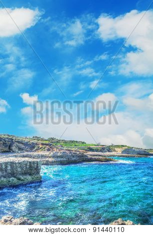 Porto Torres Rocky Shore Under A Cloudy Sky