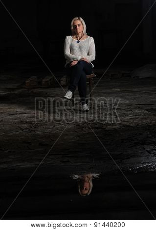 Portrait of beautiful woman in an abandoned factory with reflection