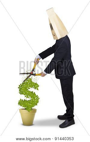Entrepreneur Using Scissors To Cut Money Tree