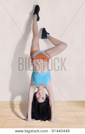 Female Athlete Doing Handstand