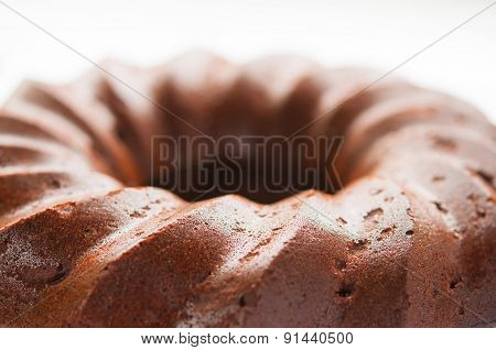 Chocolate honey cake and on white plate close up
