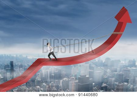 Little Businessman Pulling Arrow Upward