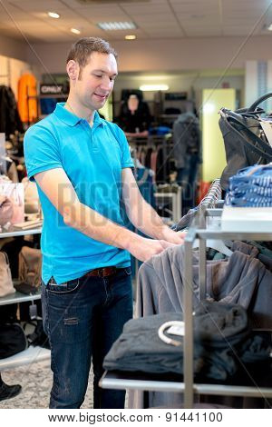 Young Man In The Clothes Shop